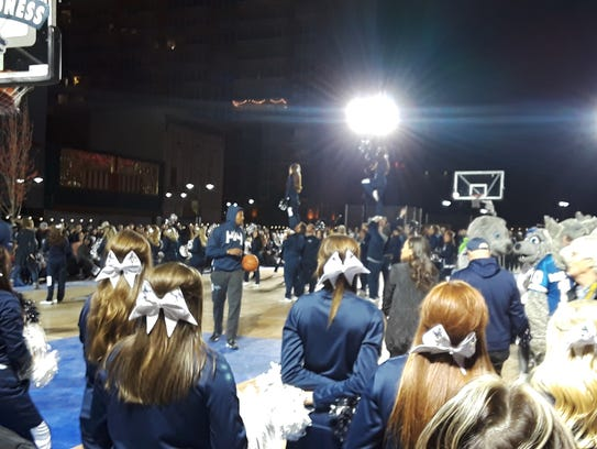The Wolf Pack players entertain the crown at Arch Madness