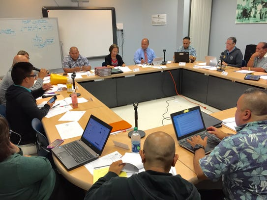 Members of the Guam Education Board discuss proposed
