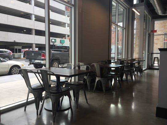 Tables set up in the dining area of Soseki Cafe in