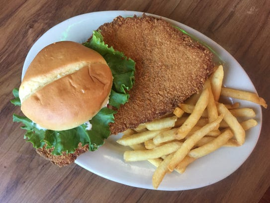 The breaded tenderloin is almost as big as its place