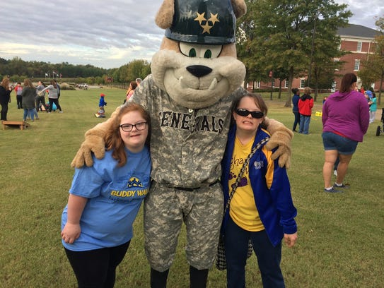 Olivia Gaston and Meghan Roeder pose with a mascot