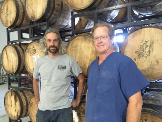 Head brewer Drew Perry (left), of Fishtown, and co-founder