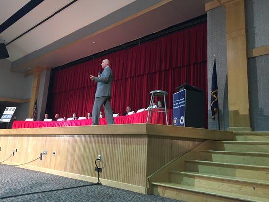 State Sen. Fred Akshar moderates a public forum on