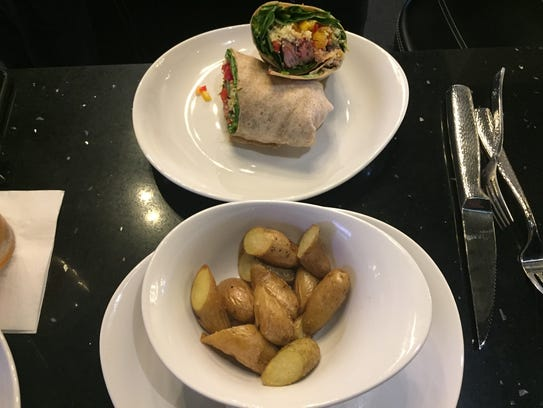 The New York steak wrap ($14) and fingerling potatoes
