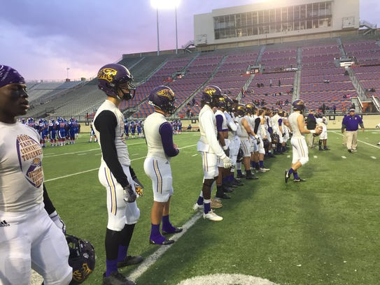 The Benton football team warms up prior to Friday's