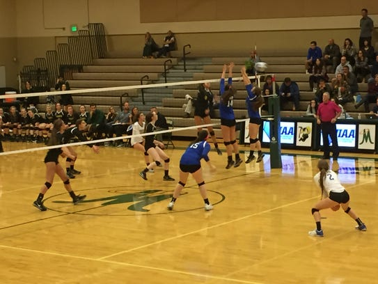 Manogue beat Reed, 3-0, (25-17, 25-9 and 25-14) in
