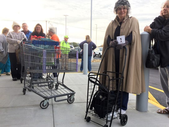 Sherrie Raymond lined up with her ALDI cart at 6 a.m.