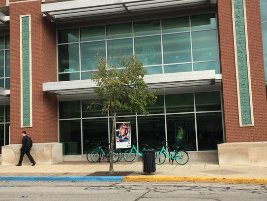 A group of VeoRide Inc.'s bikes wait for riders outside