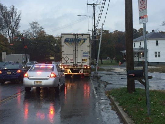 A tractor-trailer snagged a traffic light at Main Road and Sherman Avenue in Vineland.