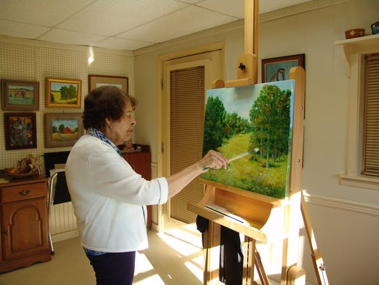 Esther Marie Versch in her art studio and gallery.