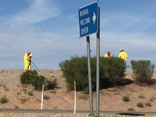 Workers from the Clark County Coroner's Office clean