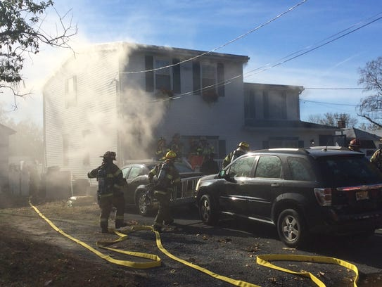 A dryer fire damaged two homes in North Middletown.