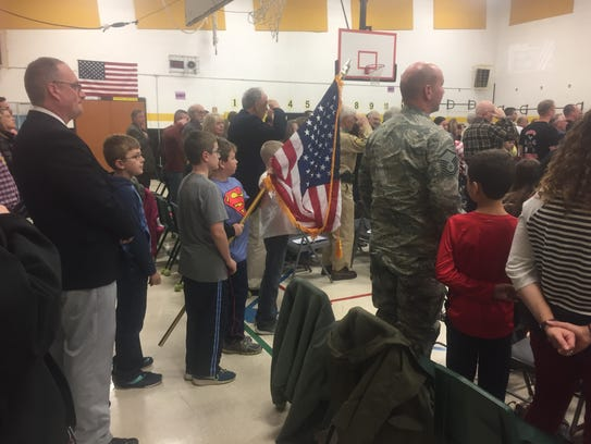 A student honor guard opened Monday's celebration to