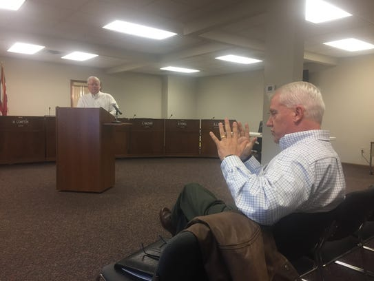 James Rosing (standing) and Paul Prater (seated) discuss