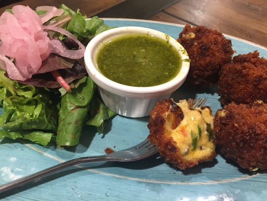 Pimento cheese fritters with chimichurri sauce from