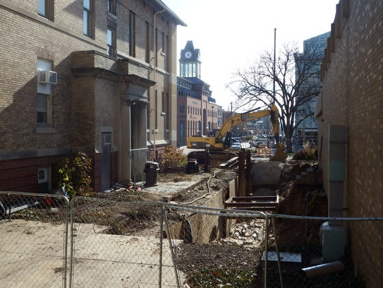 The sidewalk being tore up next to the University of