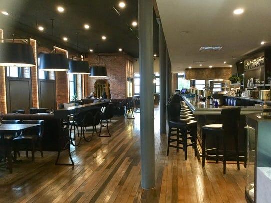 A bar and restaurant greets visitors at the entrance