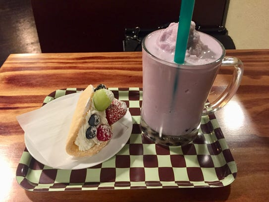 A fruit cake and a taro bubble tea at Cafe LaLa in