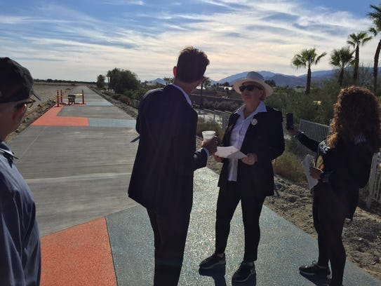 Tom Kirk, center left, executive director of the Coachella