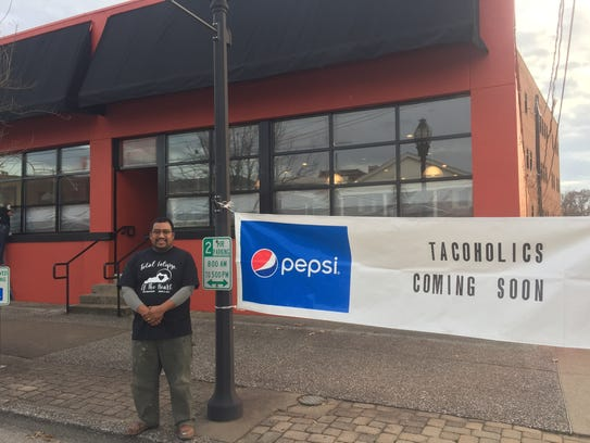 Marcos Nicolas poses in front of the new Tacoholics location, which will take up residence in the old Downtown Diner building at 122 First Street. He's completely redone the inside, with new paint, flooring, bathrooms and more.