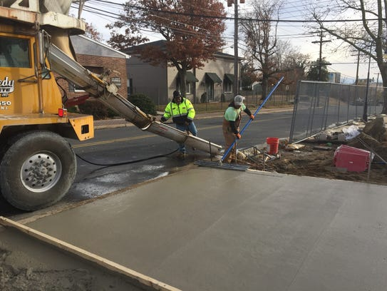 Fresh poured concrete walkway on Wednesday at Millville