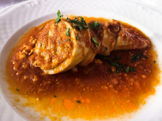 Stuffed squid with tomato sauce is a traditional dish