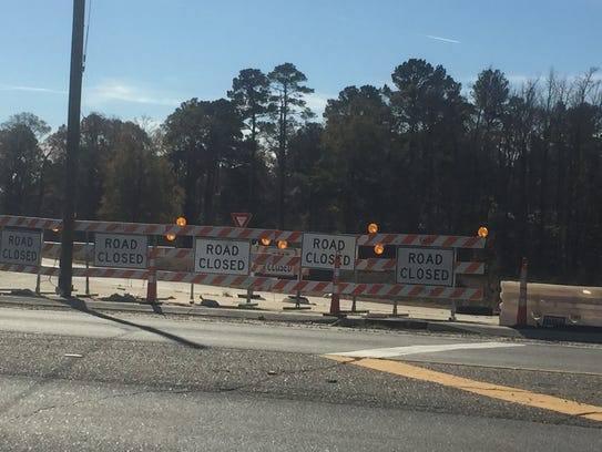 Road Closed signs blocking off an interstate ramp along