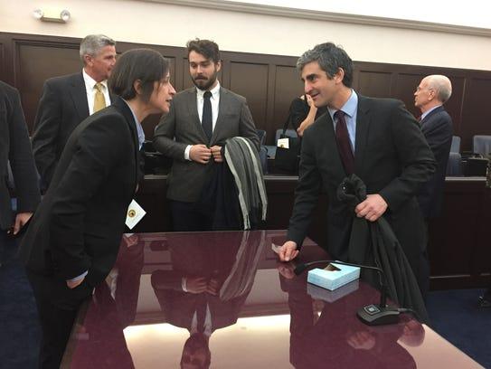U.S. Attorney Christina Nolan, left, speaks with Burlington