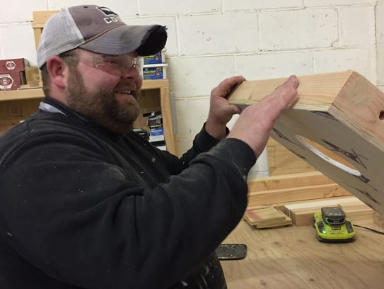Dan Macpherson, shop manager at Signs by the Sea in