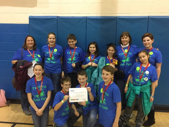 The Techno Brick Rats competition team and coaches