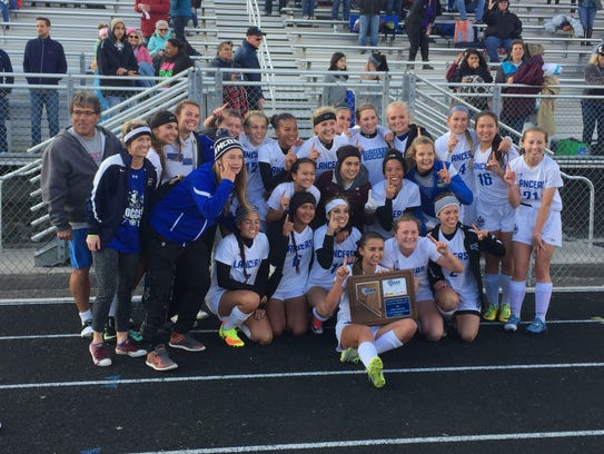 McQueen won the Northern Region 4A girls soccer championship.