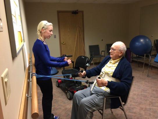 Trainer Taylor Hahn works with Paul Weninger on shoulder