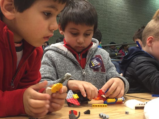 Rocco Paolella, 5, and his brother, Massimo, 6, play