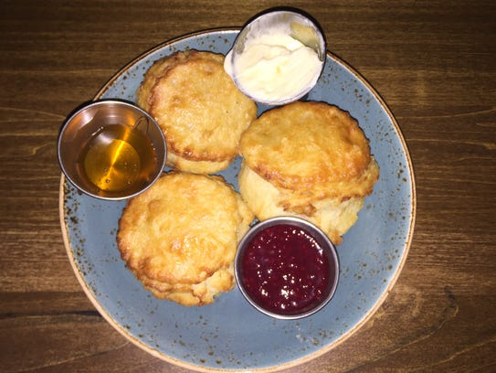House biscuits with honey, raspberry jam and salted