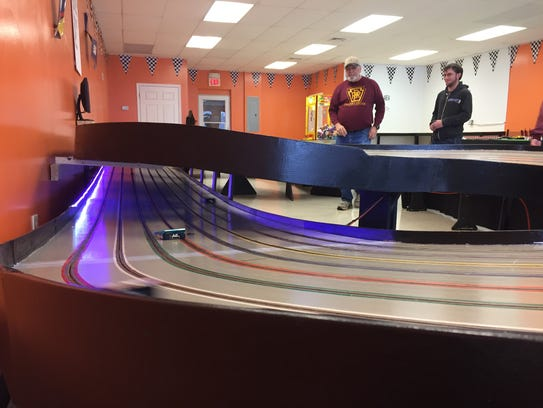 Mike Brouse, left, and owner Colton Harmon race slot cars at Slots of Fun Speedway at 130 Eisenhower Drive. Harmon hopes to open by mid-January.