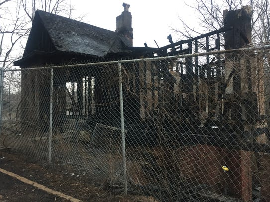 The house at 144 Park Ave. N. burned Sunday night. The more than 100-year-old house was on a street cut off by new bridge construction in the 1970s in what is now the River Arts District.