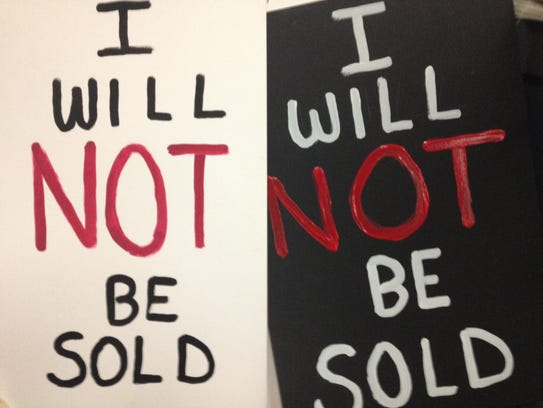 High school students carried signs emblazoned with