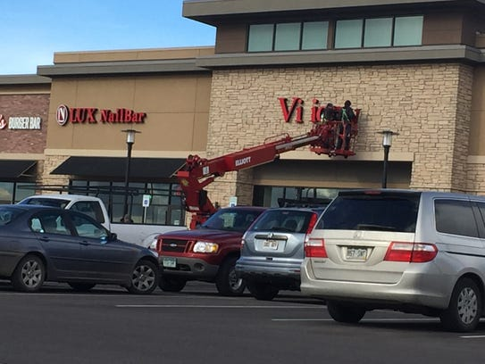 The sign for Vision Works goes up at Johnstown Plaza