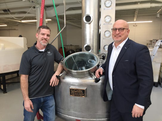 Mike Bird and Scott Ellis of Michigrain Distillery on Jan. 19. The distillery sells bulk spirits to other distilleries in the state.
