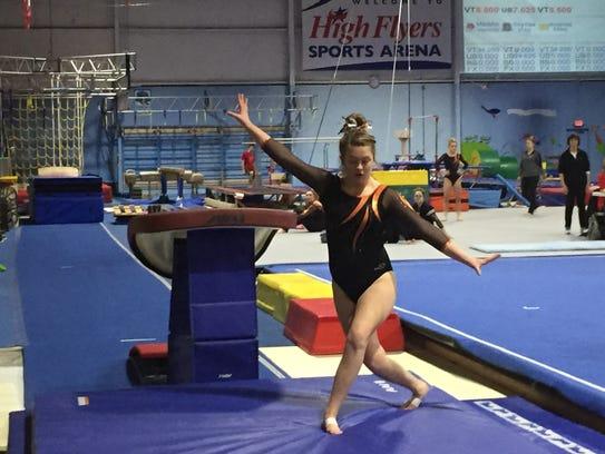 Lauren Mercer lands a vault during a gymnastics meet