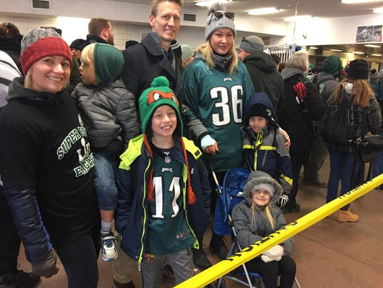 The Hill family of Medford waits to climb up to the PATCO Hi-Speedline train platform at the Woodcrest station in Cherry Hill to attend the Eagles parade in Philadelphia and celebrate the team's first Super Bowl win. PATCO carried more than 70,000 passengers to the parade. Thursday.