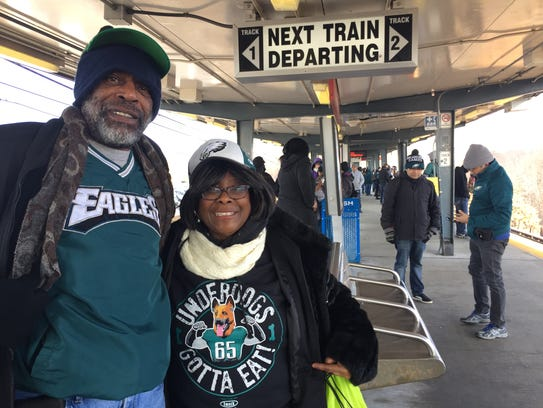 Bridgeton couple Jerry and Deborah Oglesby wait for a PATCO train in Lindenwold after the crowd thinned Thursday morning to ride to Philadelphia to view the Eagles championship parade.