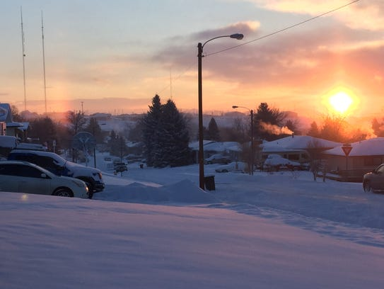 A snowy sunrise over a neighborhood in the Riverview