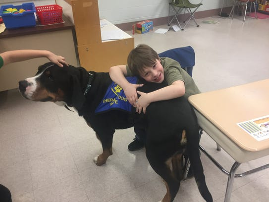 Skye gets a hug from student Shane Tenowich during