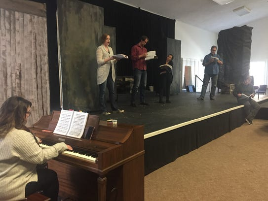 Accompaniest Natasha Smoot plays the piano as  opera
