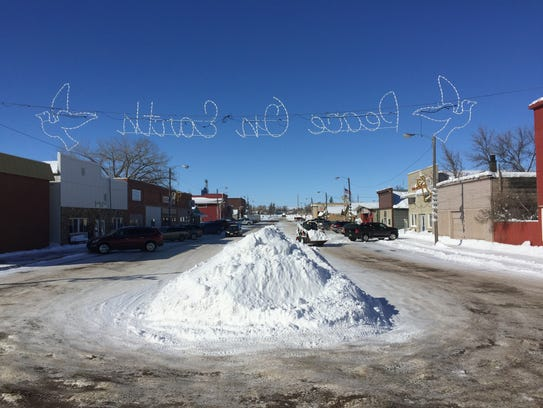 Snow is piled in the middle of main street in Big Sandy.