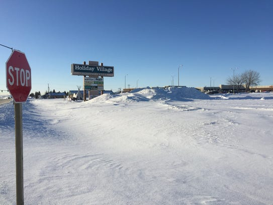 Huge piles of snow at Holiday Village in Havre, where
