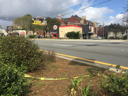 Police tape remains along Tennessee Street where police
