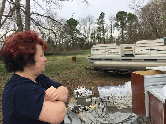 Connie Parkerson looks over the pontoon boat that was