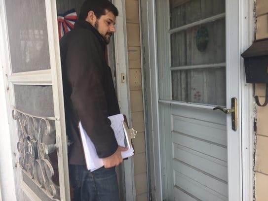 Incumbent Adam Roof goes door to door in Ward 8 prior